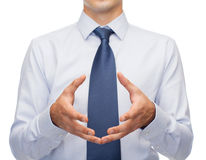 Buisnessman holding something in his hands Stock Photo