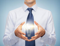 Buisnessman holding something in his hands Royalty Free Stock Photo