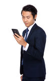 Buisnessman look at cell phone Royalty Free Stock Photography