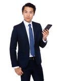 Buisnessman look at mobile phone Stock Photos