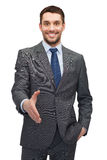 Buisnessman with open hand ready for handshake Stock Photos