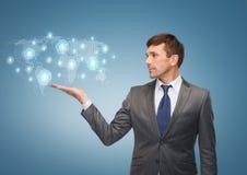 Buisnessman ou professor que mostram o holograma do mapa do mundo Fotografia de Stock