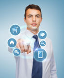 Buisnessman pointing finger to virtual screen Stock Images