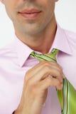 Buisnessman putting on tie Royalty Free Stock Photo