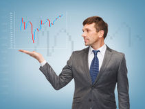 Buisnessman showing forex chart Stock Photography