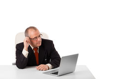 Buisnessman sitting at desk and looking laptop with copy space Royalty Free Stock Photography