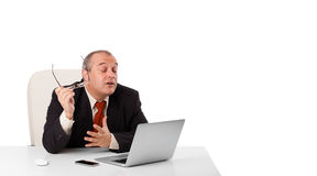 Buisnessman sitting at desk and looking laptop with copy space Stock Photo