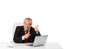 Buisnessman sitting at desk and looking laptop with copy space Royalty Free Stock Photo