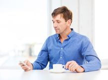 Buisnessman with smartphone and cup of coffee Royalty Free Stock Photo