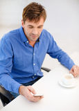 Buisnessman with smartphone and cup of coffee Royalty Free Stock Image