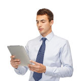 Buisnessman with tablet pc Stock Image