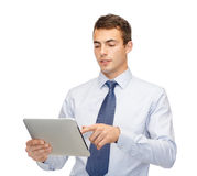 Buisnessman with tablet pc Stock Photos