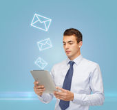 Buisnessman with tablet pc and envelope Stock Images