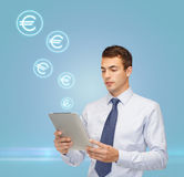 Buisnessman with tablet pc and euro icons Stock Image