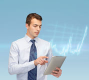 Buisnessman with tablet pc and forex chart Royalty Free Stock Images