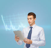 Buisnessman with tablet pc and forex chart Royalty Free Stock Photos