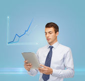 Buisnessman with tablet pc and graph Stock Photo