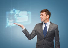 Buisnessman or teacher showing virtual screen Stock Image
