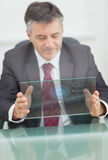 Buisnessman using futuristic touchscreen Royalty Free Stock Photography