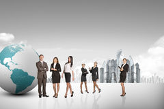 Buisnesspeople with earth globe Royalty Free Stock Image