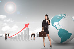 Buisnesspeople with growth graph and earth Royalty Free Stock Image