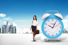 Buisnesswoman with big alarm clock Royalty Free Stock Photos