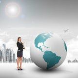 Buisnesswoman with big earth globe Stock Photography
