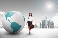 Buisnesswoman with big earth globe Stock Images