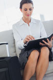 Buisnesswoman checking her diary Royalty Free Stock Images