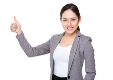 Buisnesswoman with thumb up Royalty Free Stock Photos