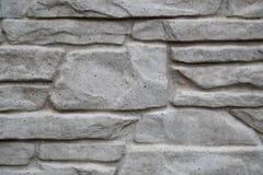 buiten kunstmatige die steenmuur van beton wordt gemaakt stock foto's