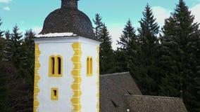 Buitenkant van middeleeuwse kerk in een bos stock footage