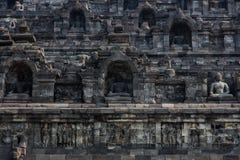 Buitenmuurdetail van Borobudur-tempel, Java, Indonesië Stock Foto