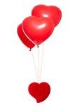 Buitensporige doos met een rode hart-vormige ballon Stock Afbeelding