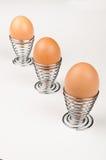 Buitensporige eierdopjes Stock Foto's