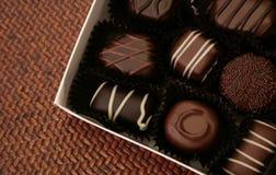 Buitensporige geassorteerde chocolade stock foto's