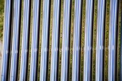 Buizen van een zonne verwarmingssysteem als achtergrond royalty-vrije stock afbeelding