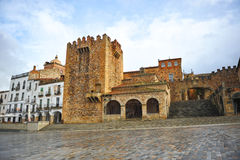 Bujaco Tower and Arc of the Star, Caceres, Extremadura, Spain. In the Main Square of Caceres, named Plaza Mayor,  is the Tower of Bujaco, the hermitage of Peace Royalty Free Stock Photography