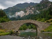 Bujaruelo ancient bridge in Pyrinees range, spain. Trekking place in huesca royalty free stock photo