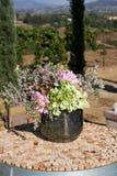Bukett av blommor i en metallbunke Fotografering för Bildbyråer