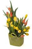 Bukett av gula och röda tulpan i en grön vas Royaltyfria Foton