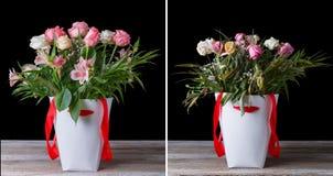 Bukett för vissnad och ny blomma i de vita askarna med röda band på en trätabell På en svart bakgrund royaltyfria bilder