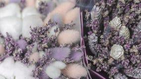 Buketter av lavendel, bomull, lagurus i kraft papper fotografering för bildbyråer
