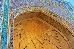 Bukhara: madrasa golden arch royalty free stock images