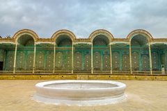 Bukhara Old City 86. Bukhara Old City Sitorai Mohi Hosa Star and Moon Garden Summer Palace Corridor with Wooden Columns and Fountain royalty free stock photo