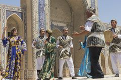 BUKHARA, UZBEKISTAN - MAY 25, 2018: Silk and Spices Festival 2018. Bukharian musicians in local dress dance royalty free stock photography