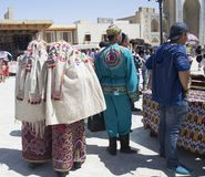 BUKHARA, UZBEKISTAN - MAY 25, 2018: Silk and Spices Festival 2018. Bukharian musicians in local dress dance royalty free stock images