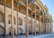 Bolo Haouz Mosque. BUKHARA, UZBEKISTAN - OCTOBER 19, 2016: Bolo Haouz Mosque. Carved wooden columns support the ceiling of the iwan summer mosque royalty free stock photo