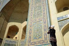 Bukhara, Uzbekistan, Silk Route. Bukhara, Uzbekistan, Tourist on the main square admiring ancient monuments of Bukhara of architectural pearl on the Silk Route royalty free stock image