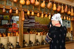 Bukhara, Uzbekistan, Silk Route. Bukhara, Uzbekistan, Tourist on the main bazaar is photographing the stall with spices in Bukhara of architectural pearl on the stock images